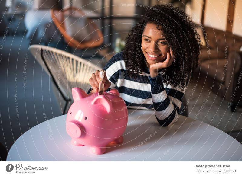 Black woman with saving piggy bank Woman Money box savings Success Business cash Coin pound sterling Beautiful Happy Cheerful investment wealth Budget