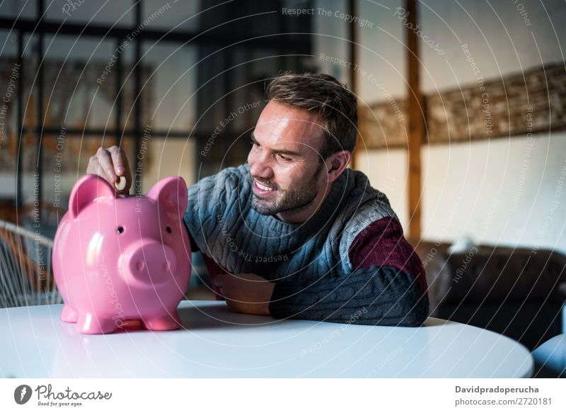 Happy young man with saving piggy bank Man Money box savings Success Business cash Caucasian Coin Euro Beautiful Cheerful investment wealth Budget