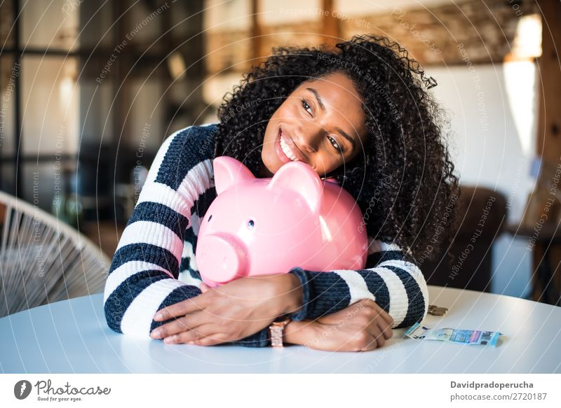 Black woman hugging her piggy bank Woman Money box savings Success Business cash Coin Euro Beautiful Happy Cheerful investment wealth Budget Financial Industry