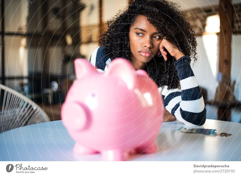 Sad frustrated black woman with piggy bank Woman Money box debt Crisis Sadness Budget Anger worried Financial Industry annoyed Stress Considerate Problem