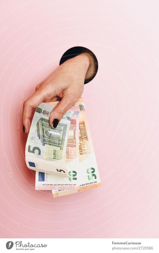 A woman's hand holding banknotes Feminine 1 Human being Money Pink 50 10 Euro Euro bill Financial Industry Hollow Circle Hand Low-cut Fingers Donation