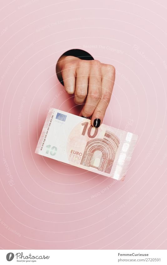 Hand of a woman holding a 10 Euro note Feminine Human being Financial Industry € Money Bank note Paying Save Pink To hold on Means of payment Colour photo