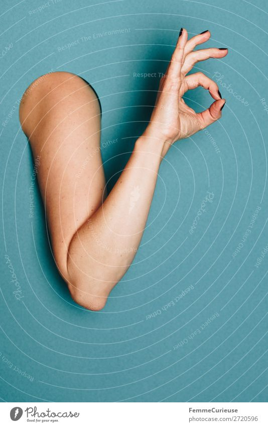 A woman's arm with her hand showing an okay sign Feminine 1 Human being Creativity OK Gesture Fingers Structures and shapes Sign Arm Turquoise Nail polish Limbs