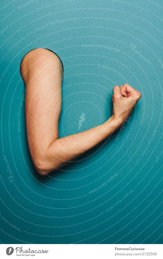 Arm of a woman with a sporty gesture Feminine Woman Adults 1 Human being Stationery Paper Sports Musculature Nerviness Tension Turquoise Fist Concentrate Circle