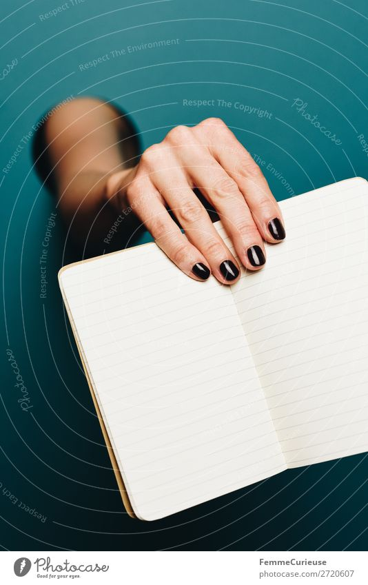 A woman's hand holding an empty notebook Feminine 1 Human being Stationery Paper Piece of paper Communicate Notebook Write Empty Nail polish Black Turquoise