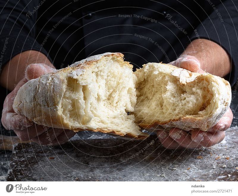fresh baked white wheat flour bread Dough Baked goods Bread Nutrition Table Kitchen Human being Hand Fingers Wood Make Dark Fresh Brown Black White Tradition