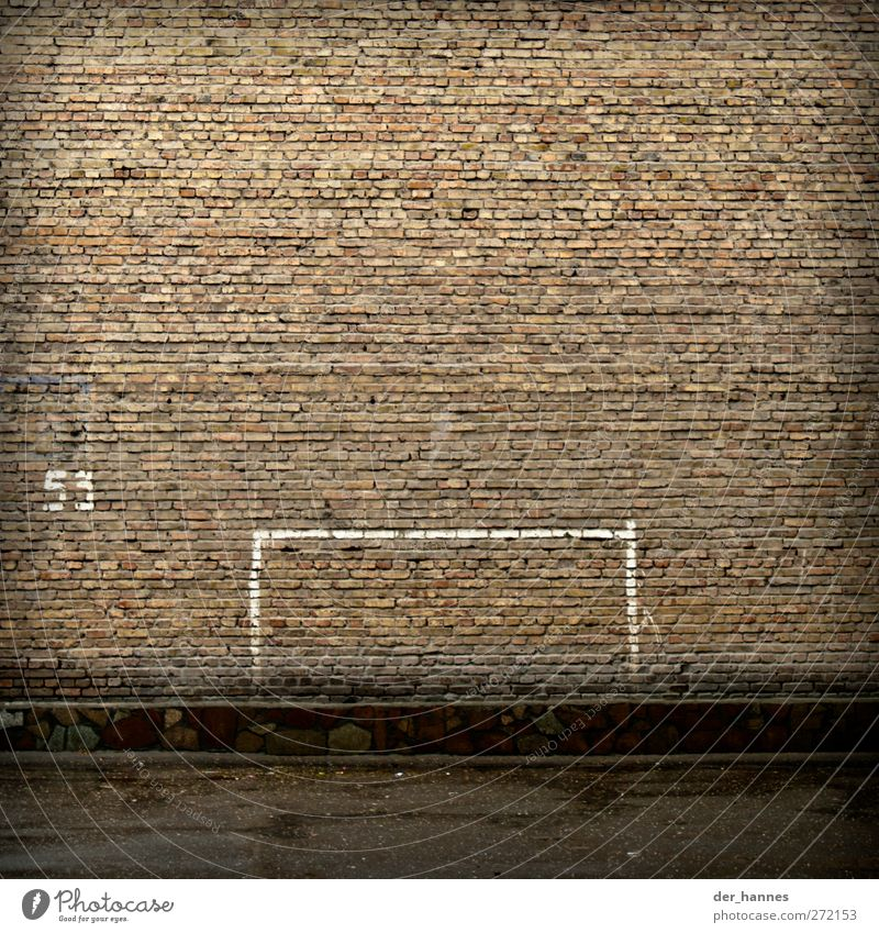53:0 Soccer Football pitch Wall (barrier) Wall (building) Digits and numbers Signs and labeling Gloomy Goal Colour photo Subdued colour Exterior shot Deserted
