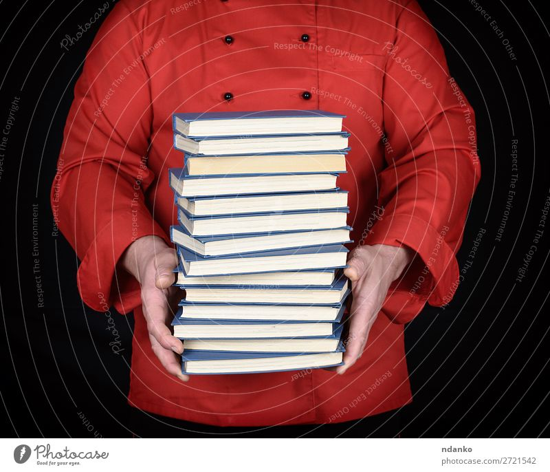 man in red uniform holds a stack of books Elegant Kitchen School Study Profession Cook Man Adults Hand Book Library Clothing Jacket Paper Stand Red Black White