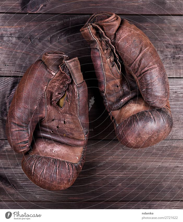 very old brown boxing gloves Sports Leather Gloves Wood Old Fitness Retro Brown Black Protection Competition Action Ancient Antique background boxer Boxing