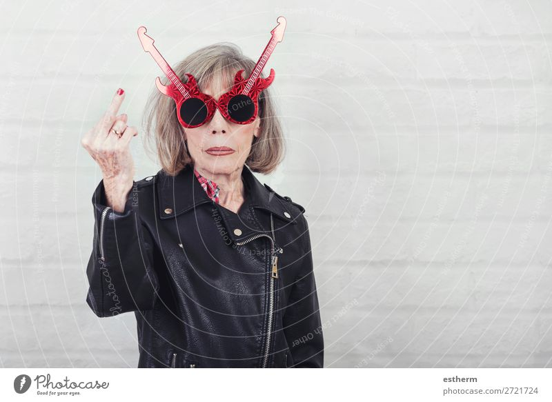 Portrait of senior woman with sunglasses insulting with finger Lifestyle Music Feasts & Celebrations Retirement Human being Feminine Female senior Woman
