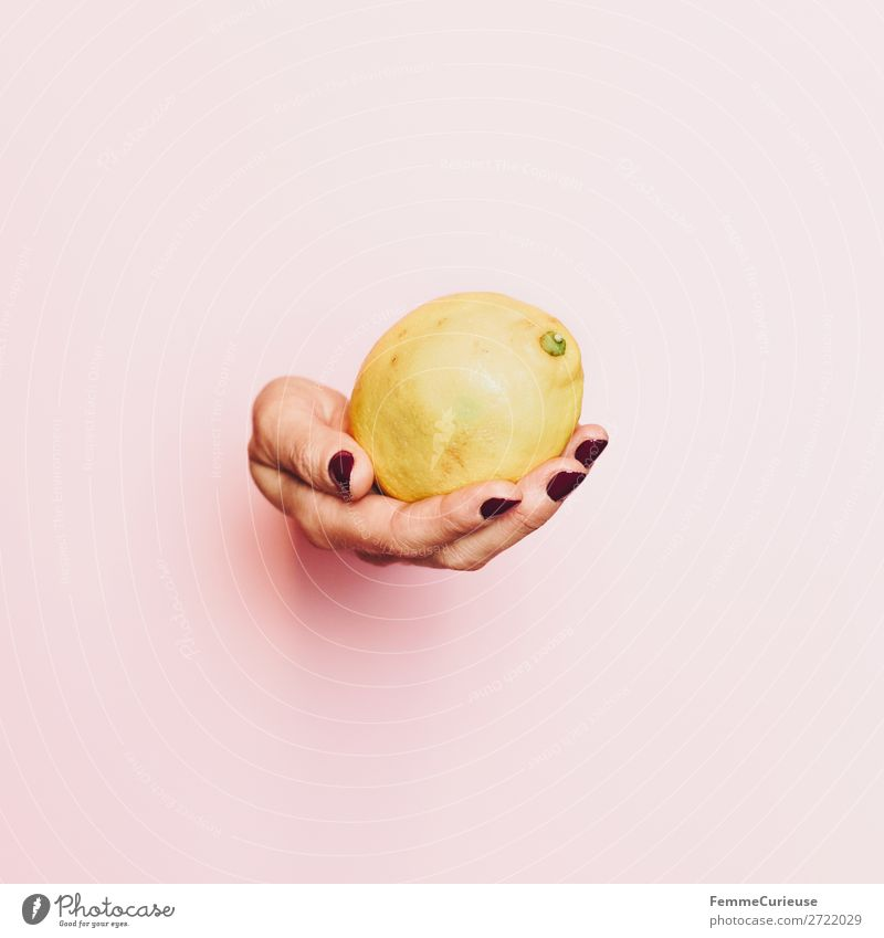 Hand of a woman with lemon in front of pink background Food Nutrition Breakfast Lunch Buffet Brunch Picnic Organic produce Vegetarian diet Feminine 1