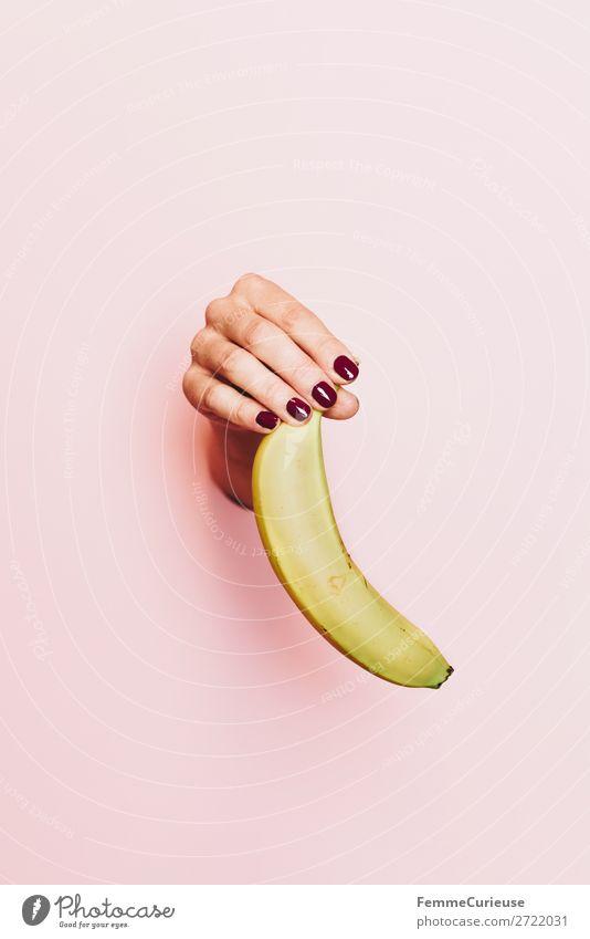 Hand of a woman holding a banana Food Breakfast Buffet Brunch Picnic Organic produce Vegetarian diet Diet Feminine 1 Human being Healthy Banana Fruit