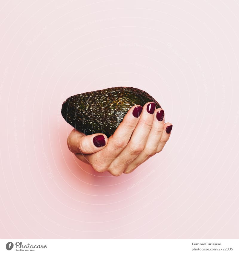 Hand of a woman with avocado in front of pink background Food Nutrition Breakfast Lunch Dinner Buffet Brunch Picnic Organic produce Vegetarian diet Diet