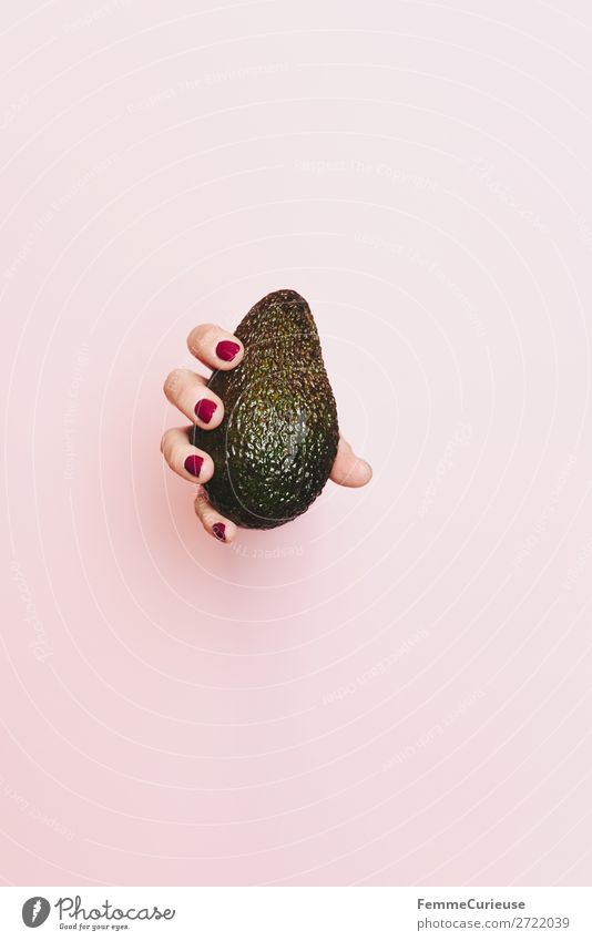 Hand of a woman holding an avocado Food Nutrition Breakfast Dinner Picnic Organic produce Vegetarian diet Diet Healthy Healthy Eating Avocado Vegetable Pink