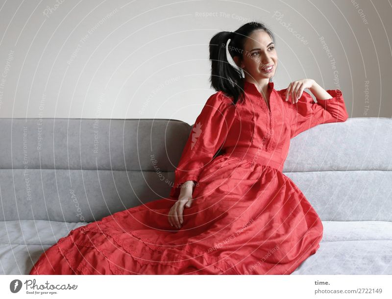 GizzyLovett Sofa Room Feminine Woman Adults 1 Human being Dress Brunette Long-haired Braids Observe Relaxation To enjoy Smiling Laughter Lie Looking
