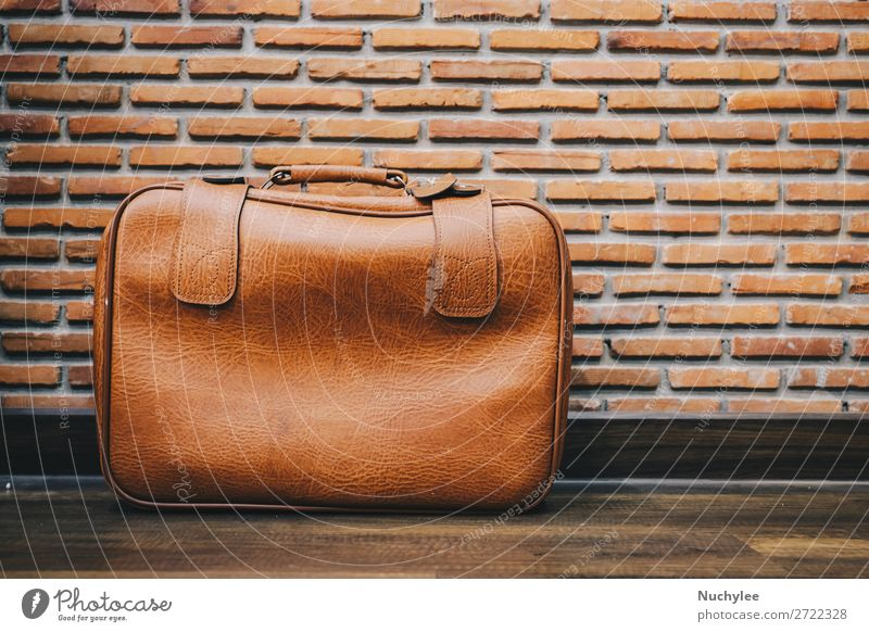 Old vintage leather luggage bag style with brick wall background Style Design Vacation & Travel Tourism Trip Art Transport Fashion Leather Suitcase To fall