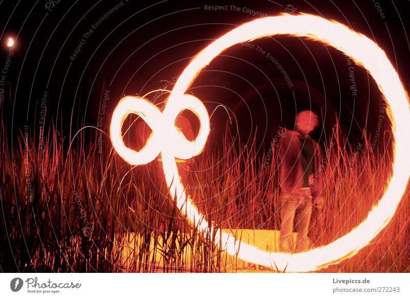 pinwheel Human being Masculine Man Adults Body 2 Environment Nature Landscape Illuminate Blaze Colour photo Exterior shot Night Light Shadow