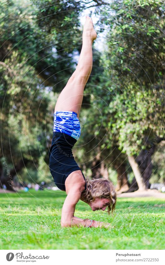 Young girl standing on her head doing yoga in the park Lifestyle Beautiful Body Relaxation Meditation Summer Sports Yoga Human being Woman Adults Nature Autumn