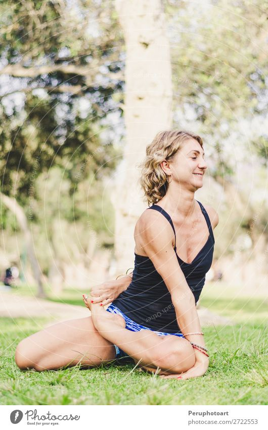 Pretty woman doing yoga exercises in the park. Woman Human being Nature Summer Beautiful Green Relaxation Lifestyle Adults Meadow Sports Happy Health care Grass