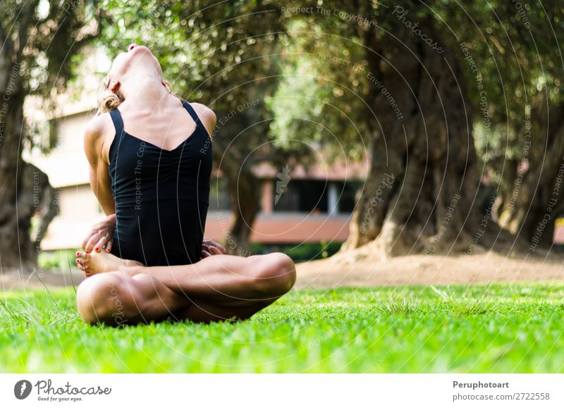 Woman practicing yoga. The Locked Lotus Pose Baddha Padmasana. Diet Lifestyle Beautiful Body Relaxation Meditation Leisure and hobbies Sports Yoga Adults Park
