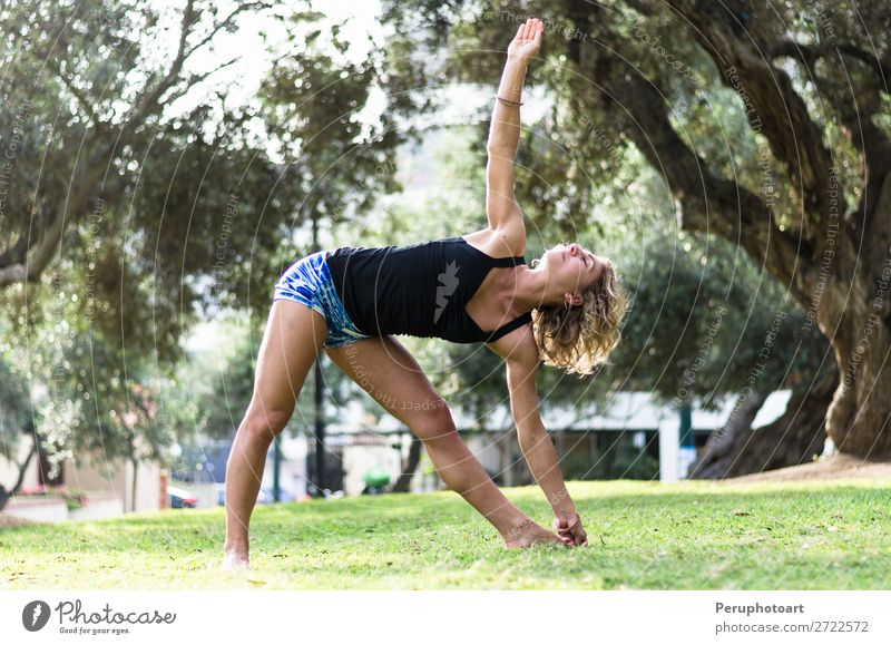 beautiful woman doing yoga outdoors in the park Beautiful Personal hygiene Alternative medicine Winter New Year's Eve Sports Yoga Woman Adults Nature Autumn