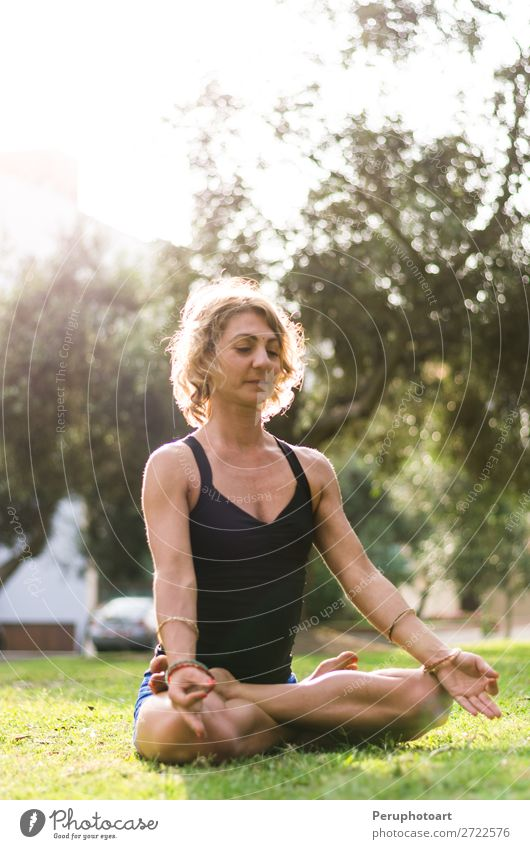 Woman Meditating And Practicing Yoga, Padmasana. Lifestyle Beautiful Body Wellness Harmonious Relaxation Meditation Adults Nature Park Fitness Sit Thin Action