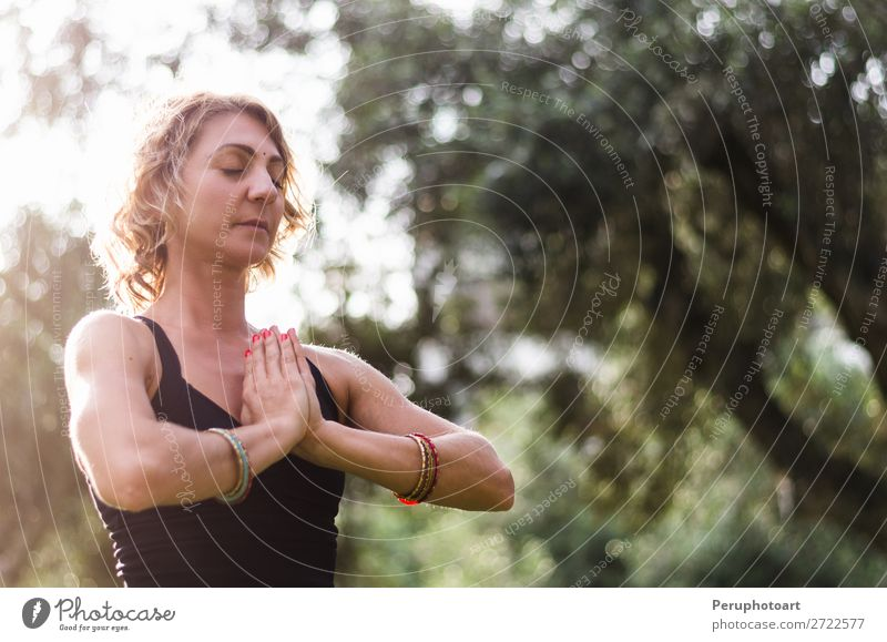 Young woman meditates in yoga asana Padmasana - Lotus pose Lifestyle Wellness Relaxation Meditation Yoga Human being Woman Adults Nature Autumn Leaf Park Wood