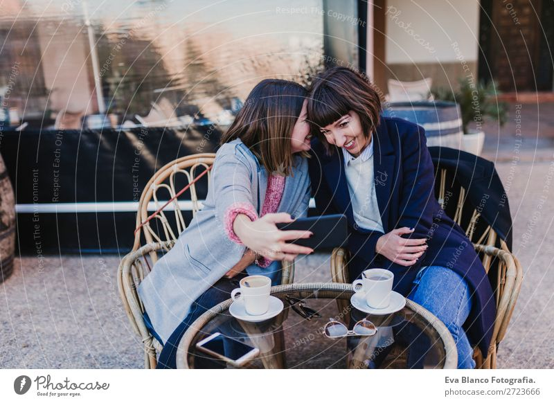 two friends in a terrace taking a selfie Beverage Coffee Tea Lifestyle Elegant Joy Happy Beautiful Leisure and hobbies Vacation & Travel To talk Cellphone