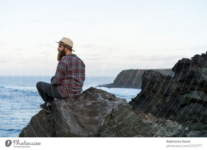 Tourist relaxing on stone at seaside Nature Man bearded Ocean Rock Stone Coast Beach Sit Resting Vacation & Travel Adventure Landscape Azores Hiking
