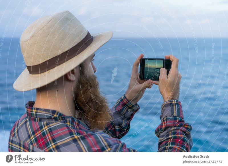 Tourist man taking a photo Nature Man bearded Cheerful Indicate seaside Ocean Vacation & Travel Azores Adventure Landscape Hiking Exterior shot Vantage point