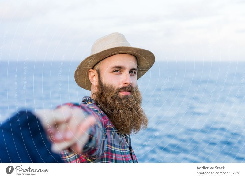 Man holding hands at seaside Tourist Nature bearded Hat Love follow me Gesture Ocean Vacation & Travel Adventure Azores Landscape Hiking Exterior shot