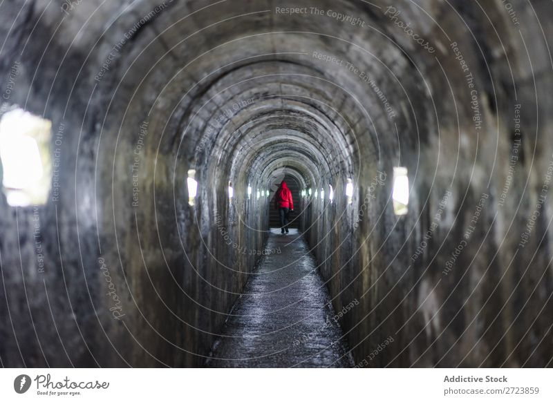 Person walking on illuminated tunnel Man Tunnel Walking Illuminate Light Dark Conceptual design Loneliness Underground Corridor Human being Azores Way out