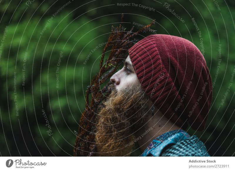Bearded man standing at branch in forest Tourist Forest Green Man bearded Nature Vacation & Travel Tourism Lifestyle Action Leisure and hobbies Human being