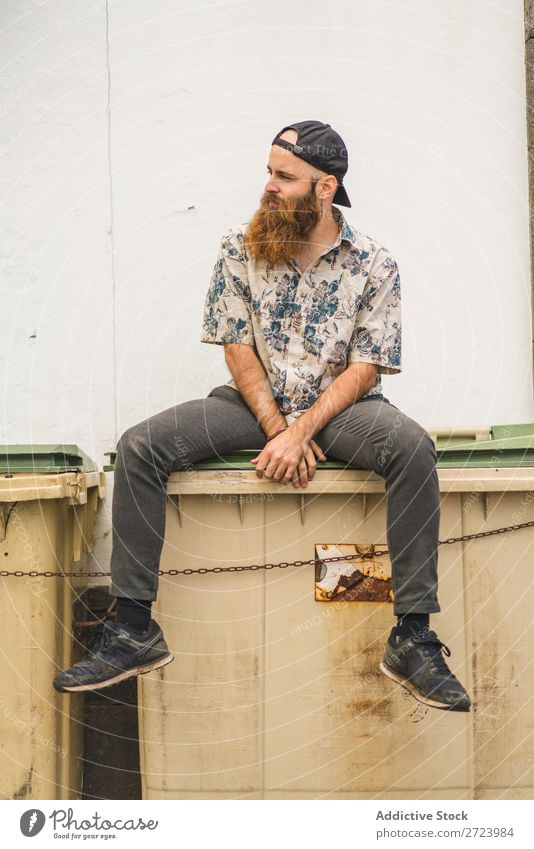 Bearded man sitting on dumpster Man City Street Sit bearded Trash container Container Lifestyle Youth (Young adults) Town Human being Guy Cool (slang) Style