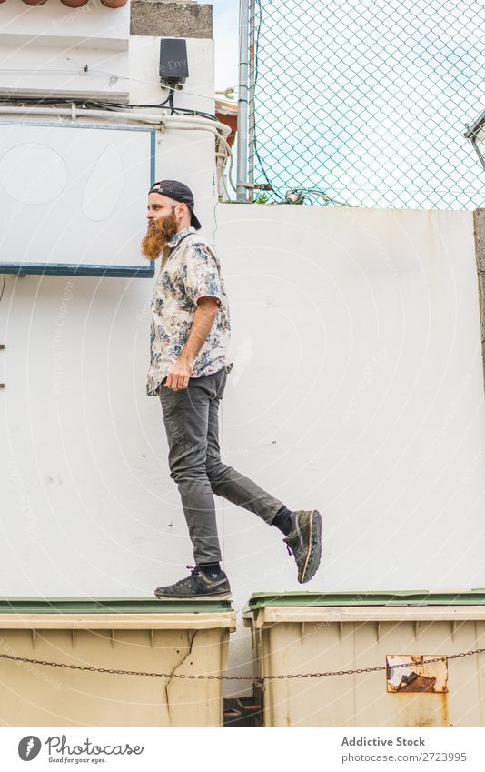 Man walking on dumpsters City Street Walking bearded Trash container Container Lifestyle Youth (Young adults) Posture stepping Town Human being Guy Cool (slang)