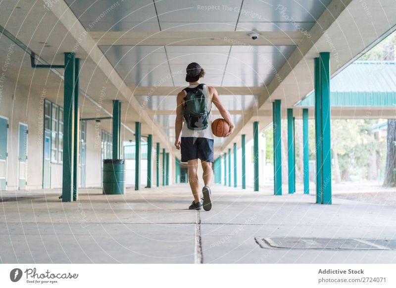 Man with ball walking outside sportsman Player Relaxation Basketball Walking finished Summer Lifestyle Playing Street Modern Action Town motivation