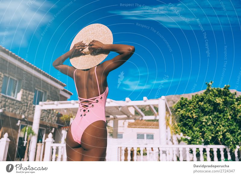Black woman relaxed in holidays Woman Ethnic Swimming pool Summer Sunbathing Vacation & Travel Beautiful tan Horizontal tanning Relaxation Copy Space Barefoot