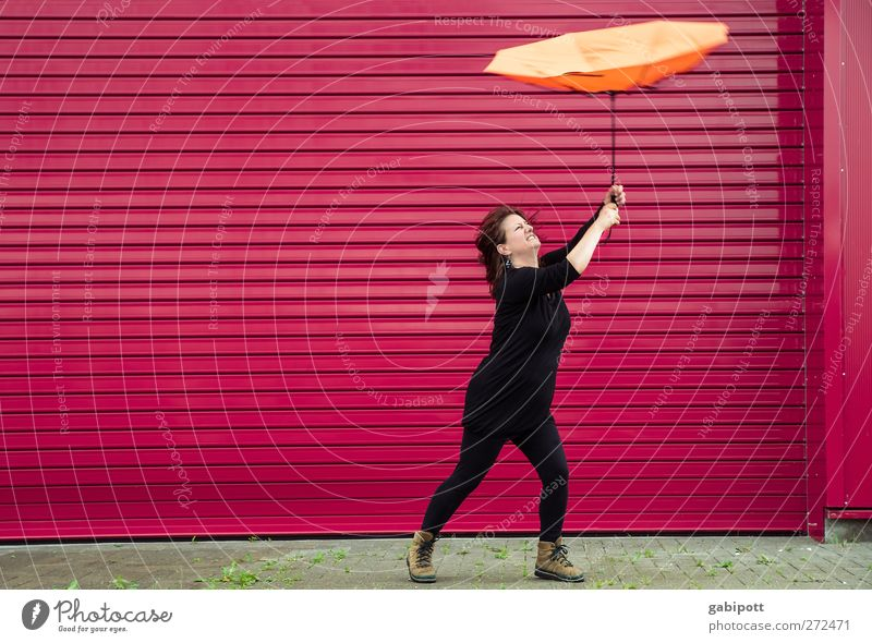 Human being Woman Red Adults Feminine Orange Rain Weather Pink Flying Wild To hold on Umbrella Storm Passion Gale