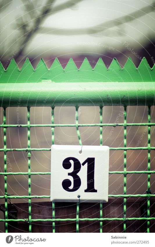 31 Fence Wooden stake Gate Garden door House number Green Black White Bend Point Digits and numbers Signs and labeling Characters Colour photo Multicoloured