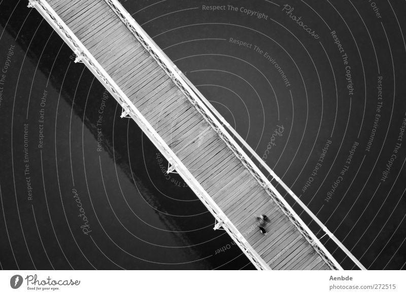 from bottom right to top left.... Human being 1 Bridge River Wooden bridge Black & white photo Exterior shot Contrast Bird's-eye view Dark background Diagonal