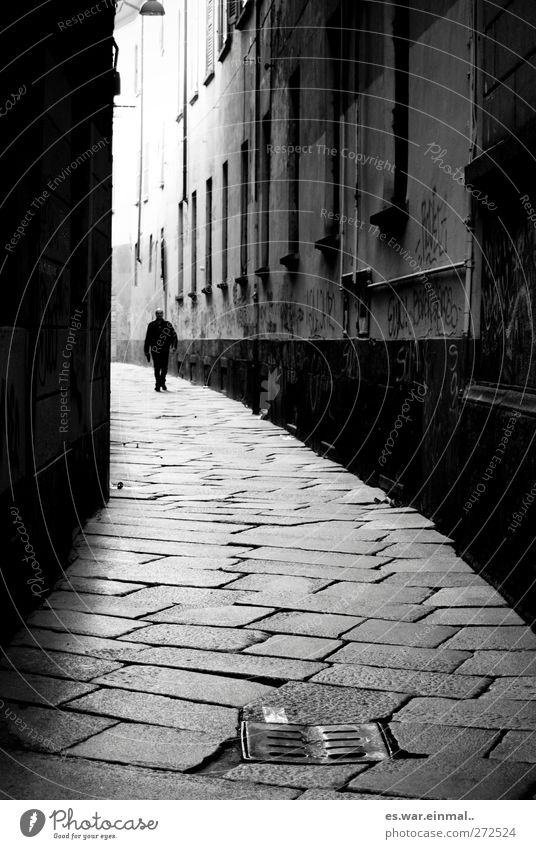 Who's afraid of the black man? Masculine 1 Human being Dark Alley Black & white photo Exterior shot