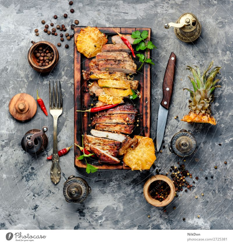 Meat with pineapple steak meat barbecue pork grilled baked roasted sirloin sliced cut pepper beefsteak dinner wooden cutting board fruit spice table tenderloin