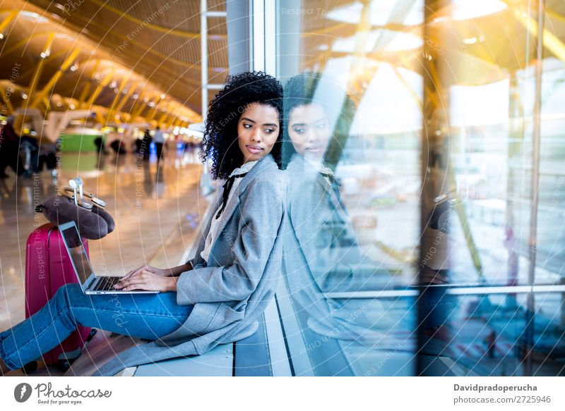 black woman working with laptop at the airport waiting at the window Airport Youth (Young adults) Smiling Wait Black Woman Story Sun