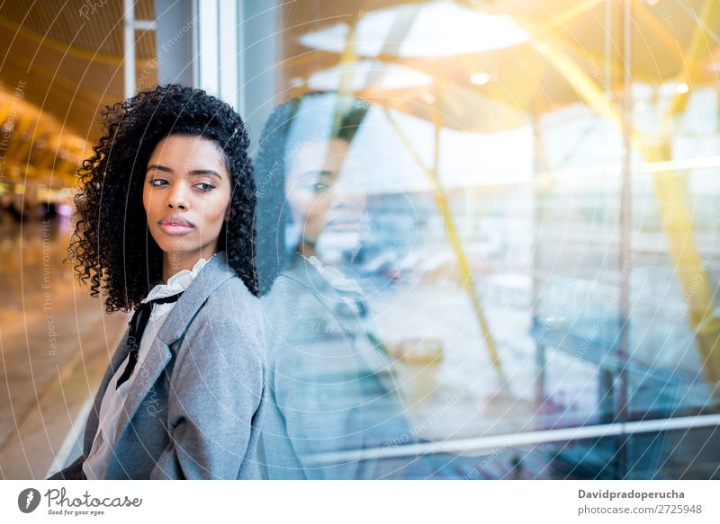 Thoughtful black woman waiting at airport Lifestyle Happy Beautiful Vacation & Travel Trip Business Human being Woman Adults Airport Departure lounge Suitcase