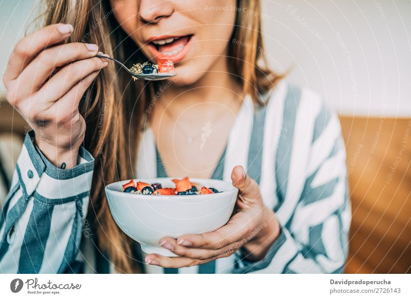 Crop woman close up eating oat and fruits bowl for breakfast Bowl Breakfast Woman Cereal porridge Hand Crops Anonymous Unrecognizable Strawberry Blueberry Oats