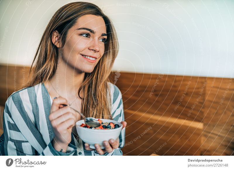 woman close up eating oat and fruits bowl for breakfast Beautiful Blueberry Bowl Breakfast Cereal Close-up Crops Dairy Delicious Dessert Diet To feed Eating
