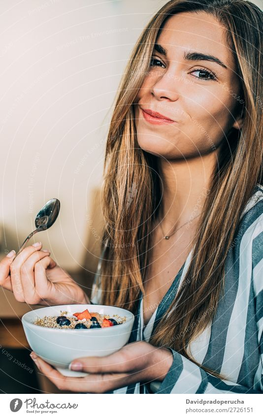 woman close up eating oat and fruits bowl for breakfast Bowl Breakfast Woman Cereal porridge Hand Smiling Crops Strawberry Blueberry Oats Healthy Food White