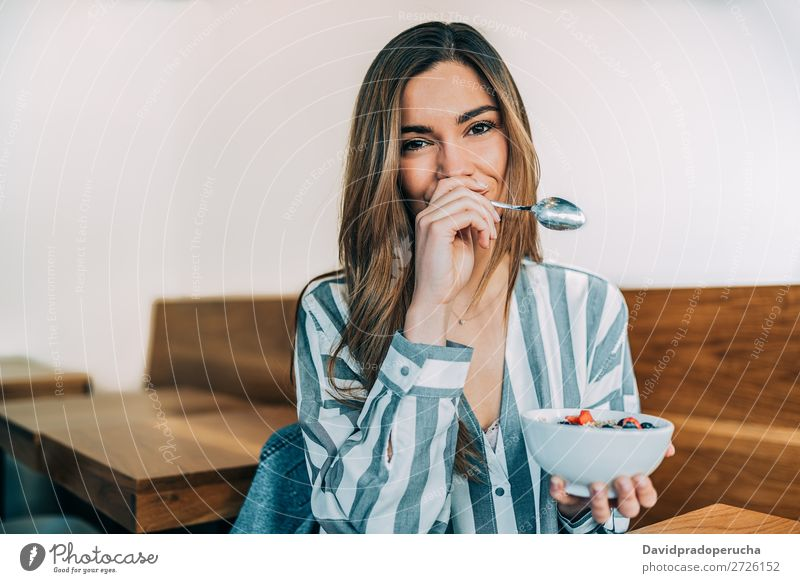 woman close up eating oat and fruits bowl for breakfast Bowl Breakfast Woman Cereal Hand Smiling