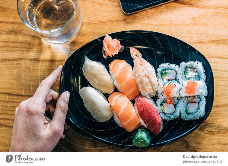 Crop woman eating sushi Sushi Woman Bird's-eye view Hand Food soy maki california roll Chopstick Roll Crops Unrecognizable Anonymous Close-up