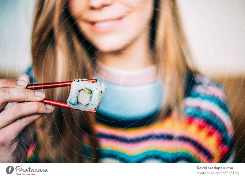 Crop woman eating sushi Sushi Woman Smiling Hand Food soy maki california roll Chopstick Roll Crops Unrecognizable Anonymous Close-up Portrait photograph Salmon